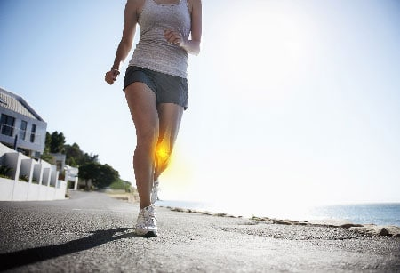 Women walking with her knee highlighted.